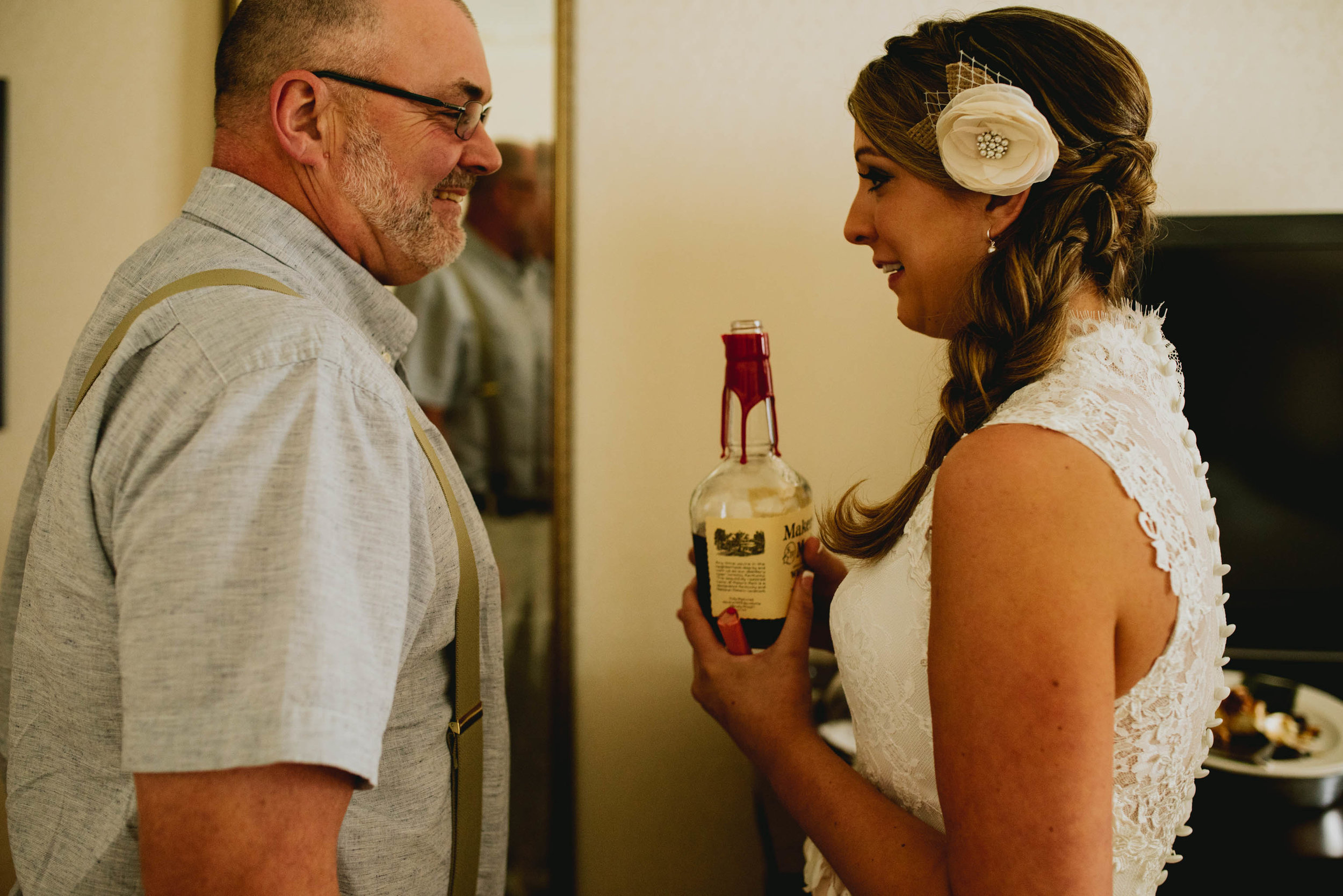bride suggesting a celebratory shot of whiskey with her dad
