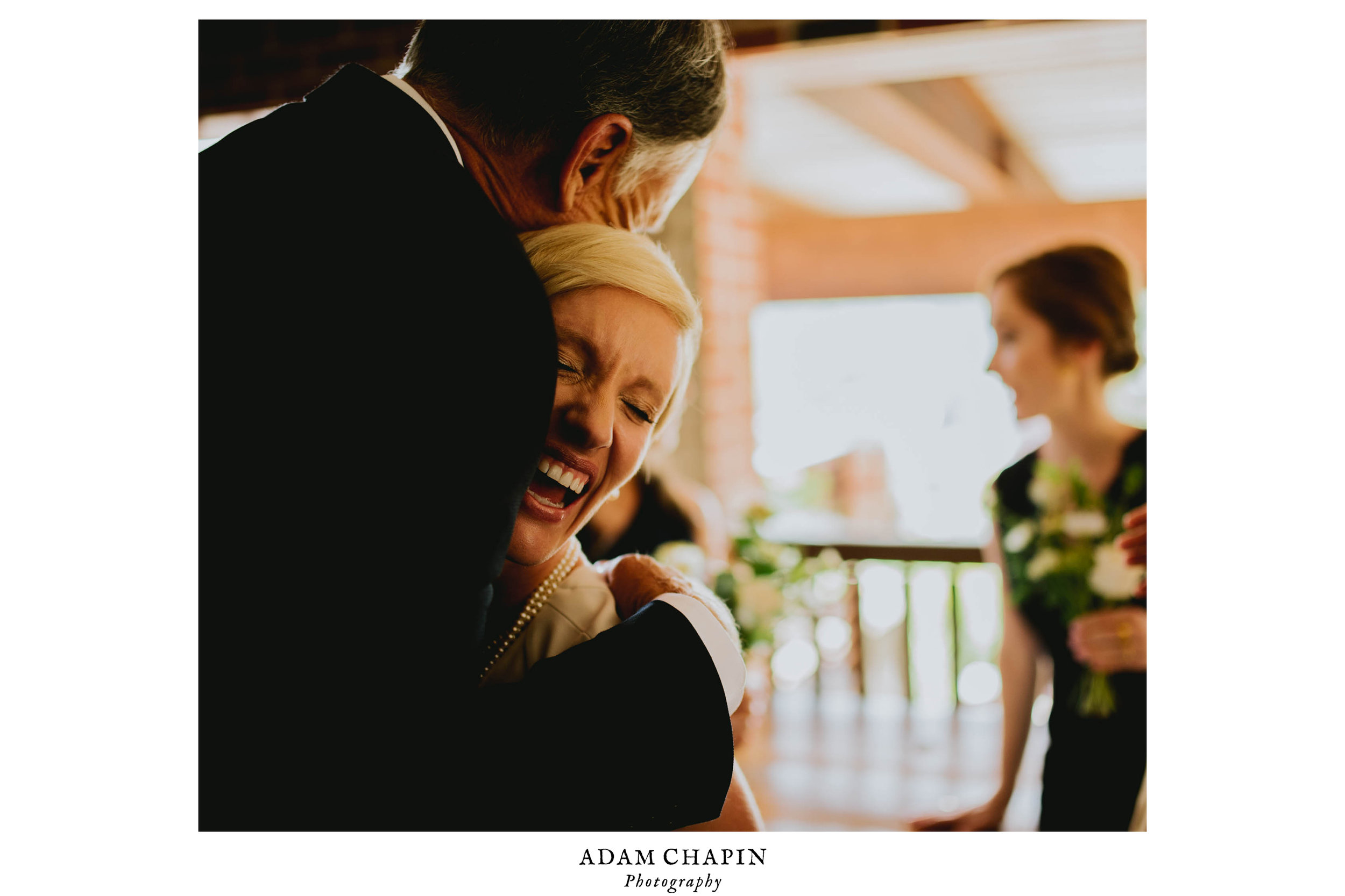 bride hugs her father in law after ceremony