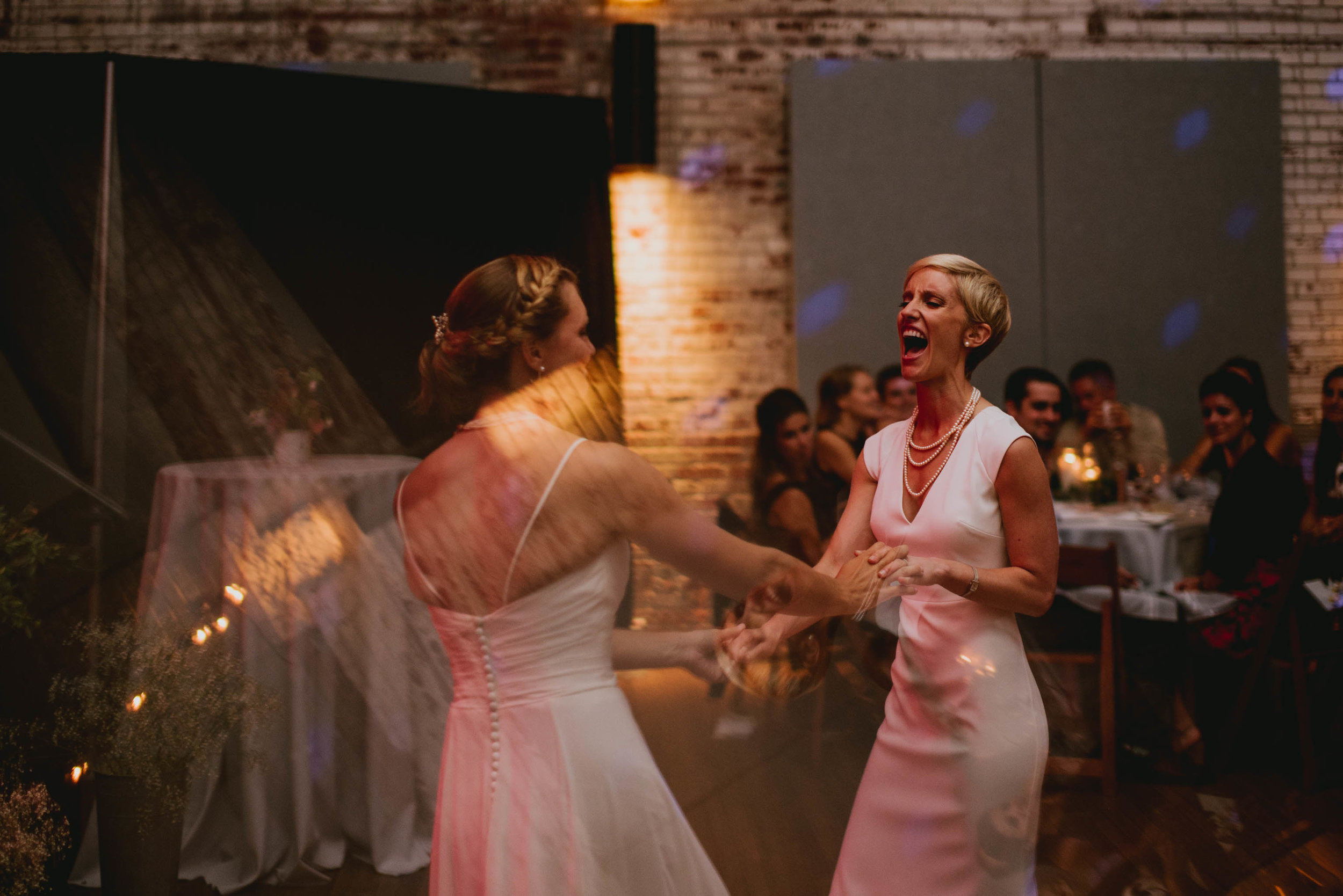 brides enjoying their first dance at the haw river ballroom
