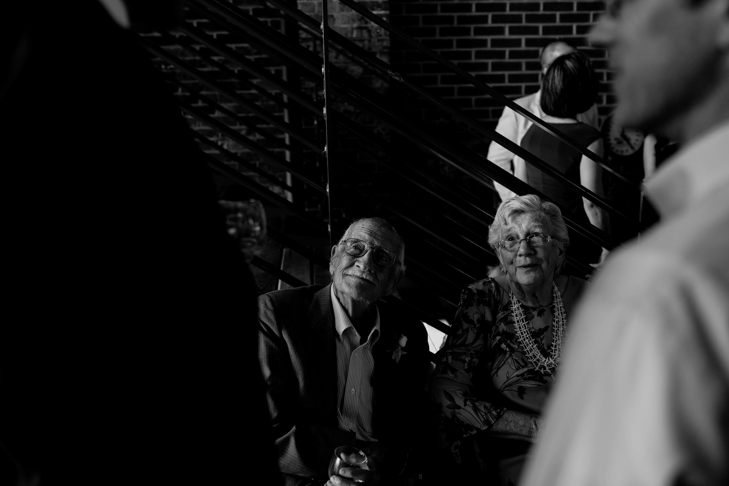 grandparents of the bride enjoying conversation with other wedding guests at the haw river ballroom