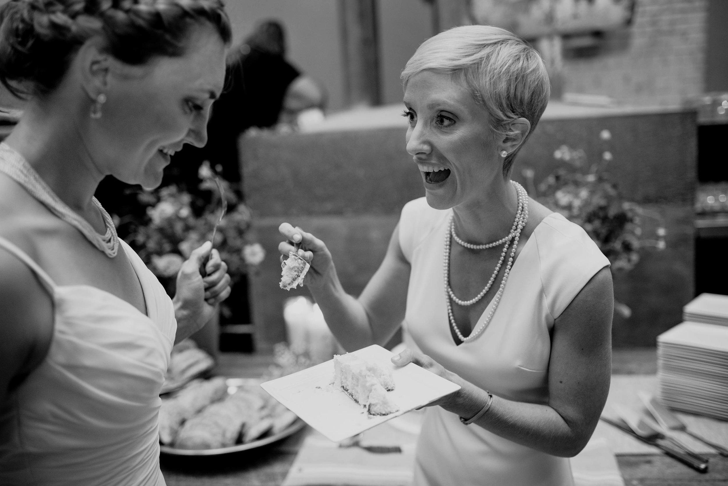 brides enjoying their cake cutting at the haw river ballroom