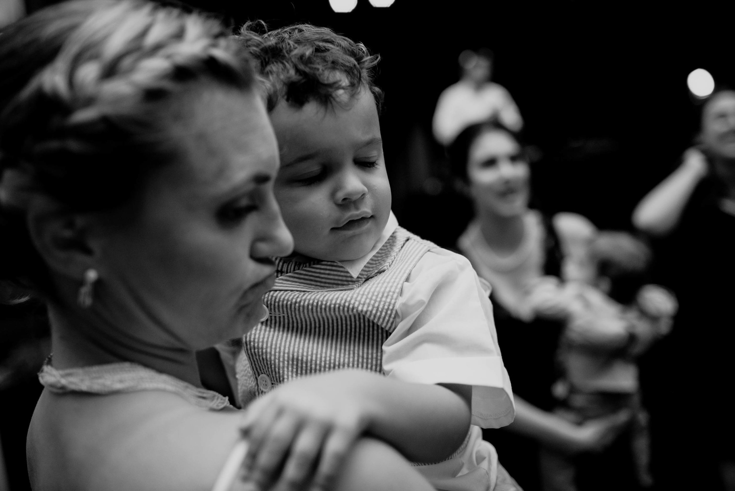 bride holding her nephew during the wedding reception at the haw river ballroom