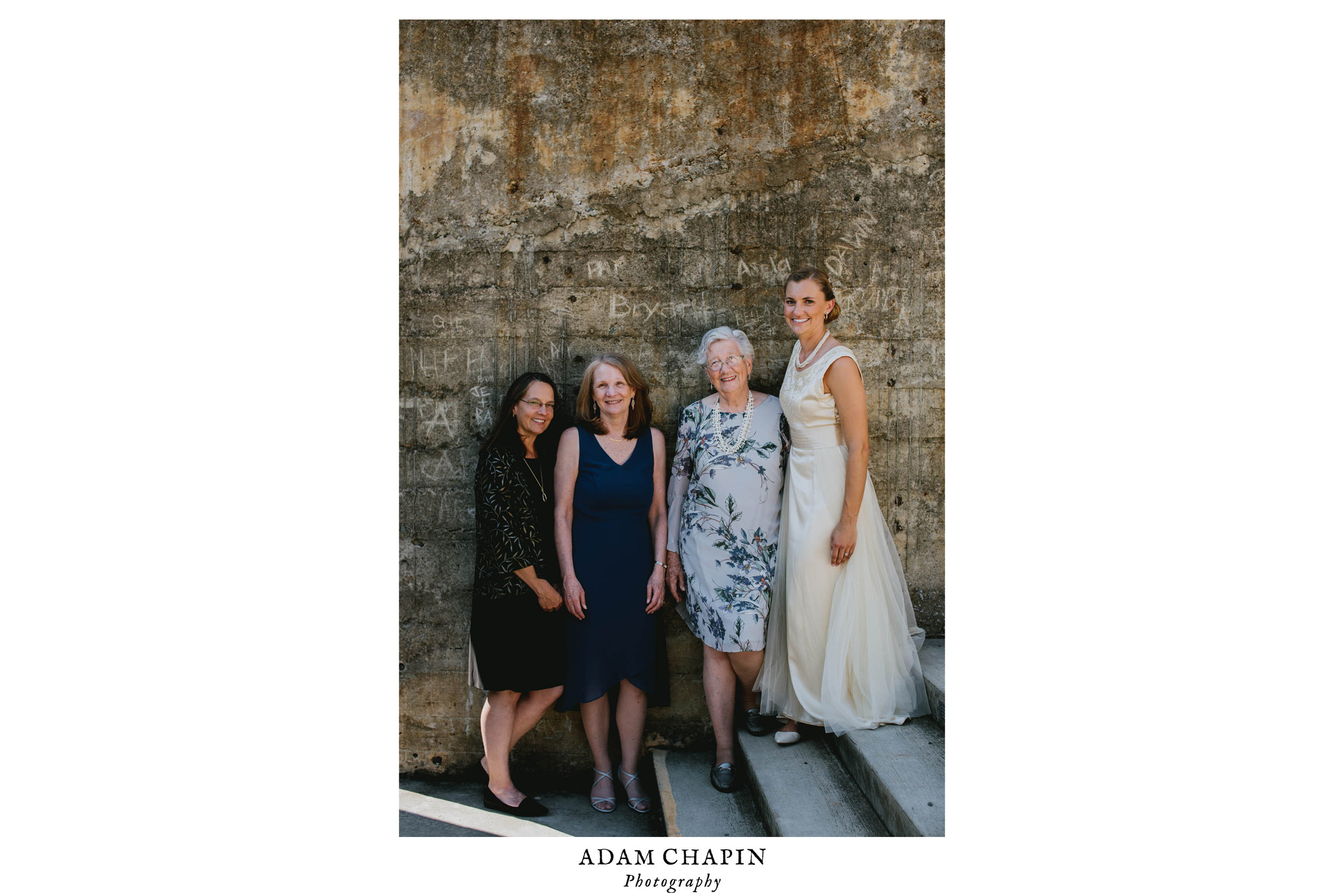 bride poses with the three other women in her family to have worn the same wedding dress made in 1929