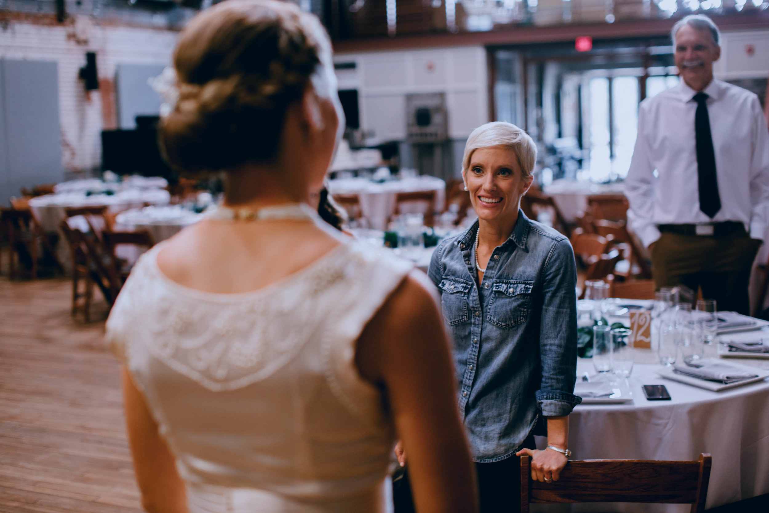 bride is ecstatic to see her bride all dressed up and ready for their haw river ballroom wedding