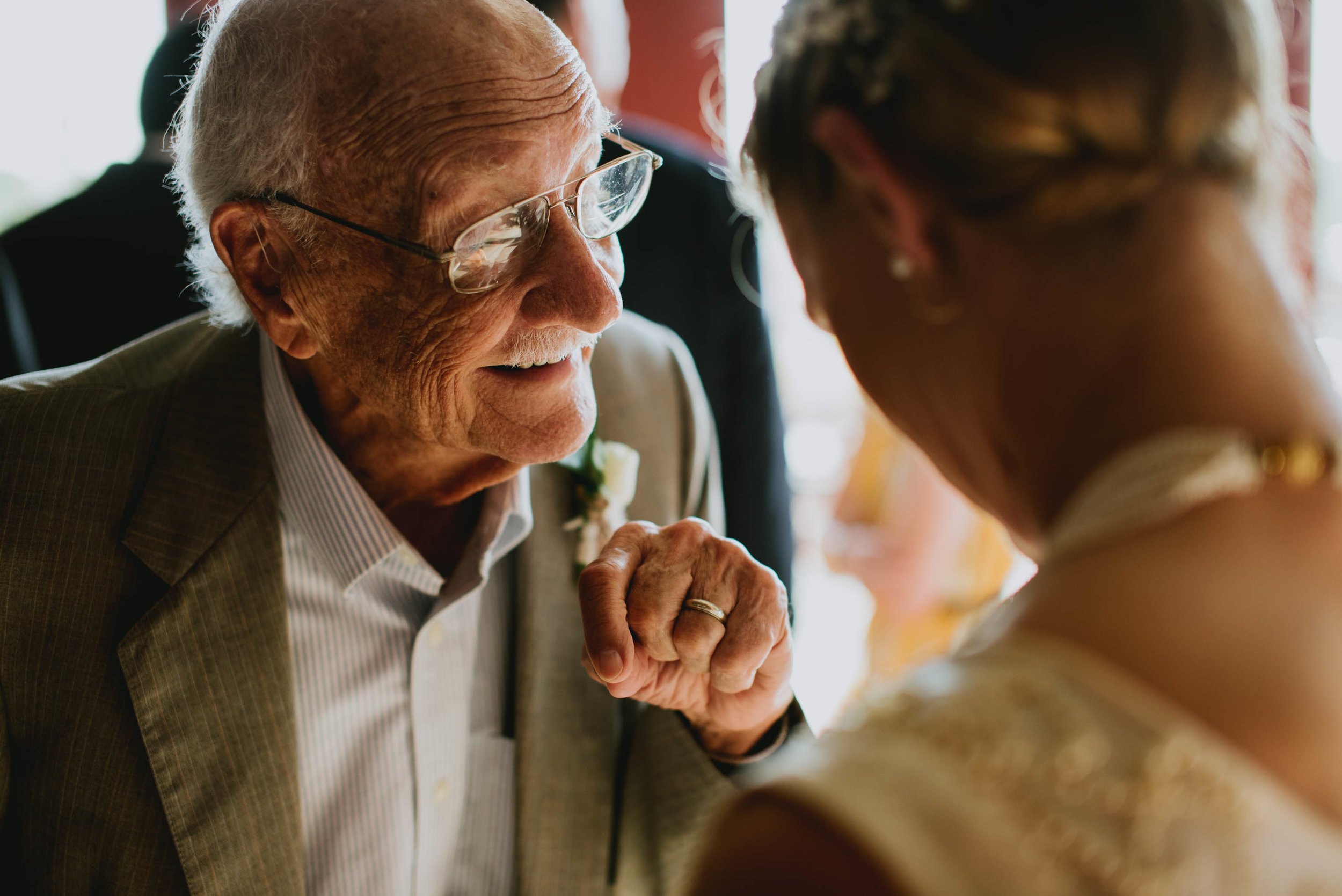bride and her grandfather sharing a conversation during cocktail hour