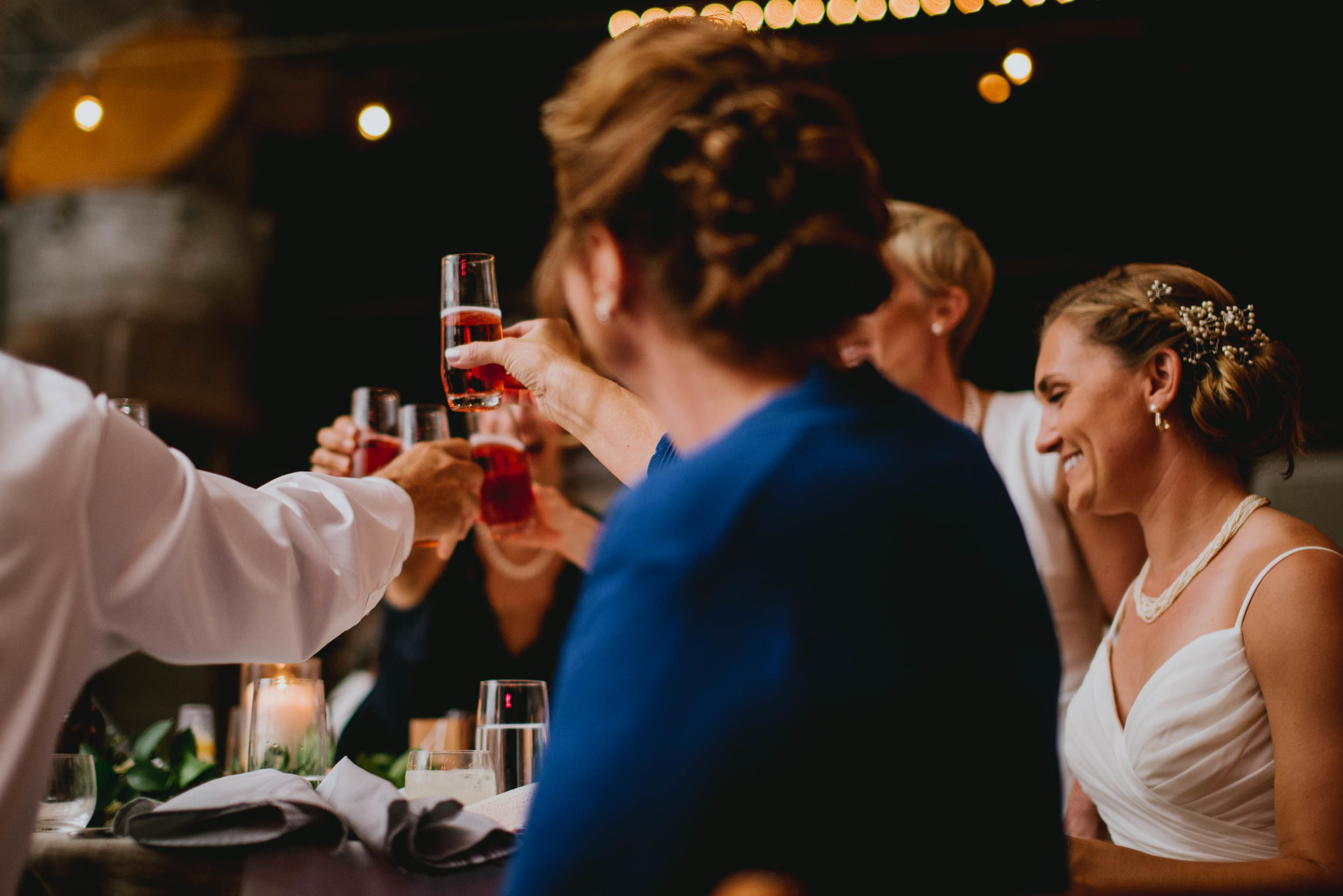 head table sharing in a toast during the wedding reception at haw river ballroom
