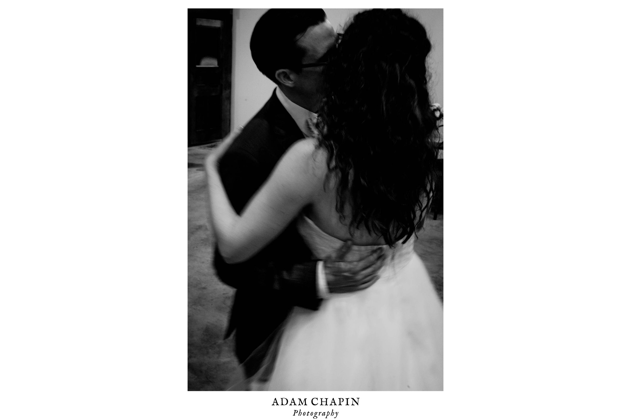 black and white photo of bride and groom dancing at their wedding reception