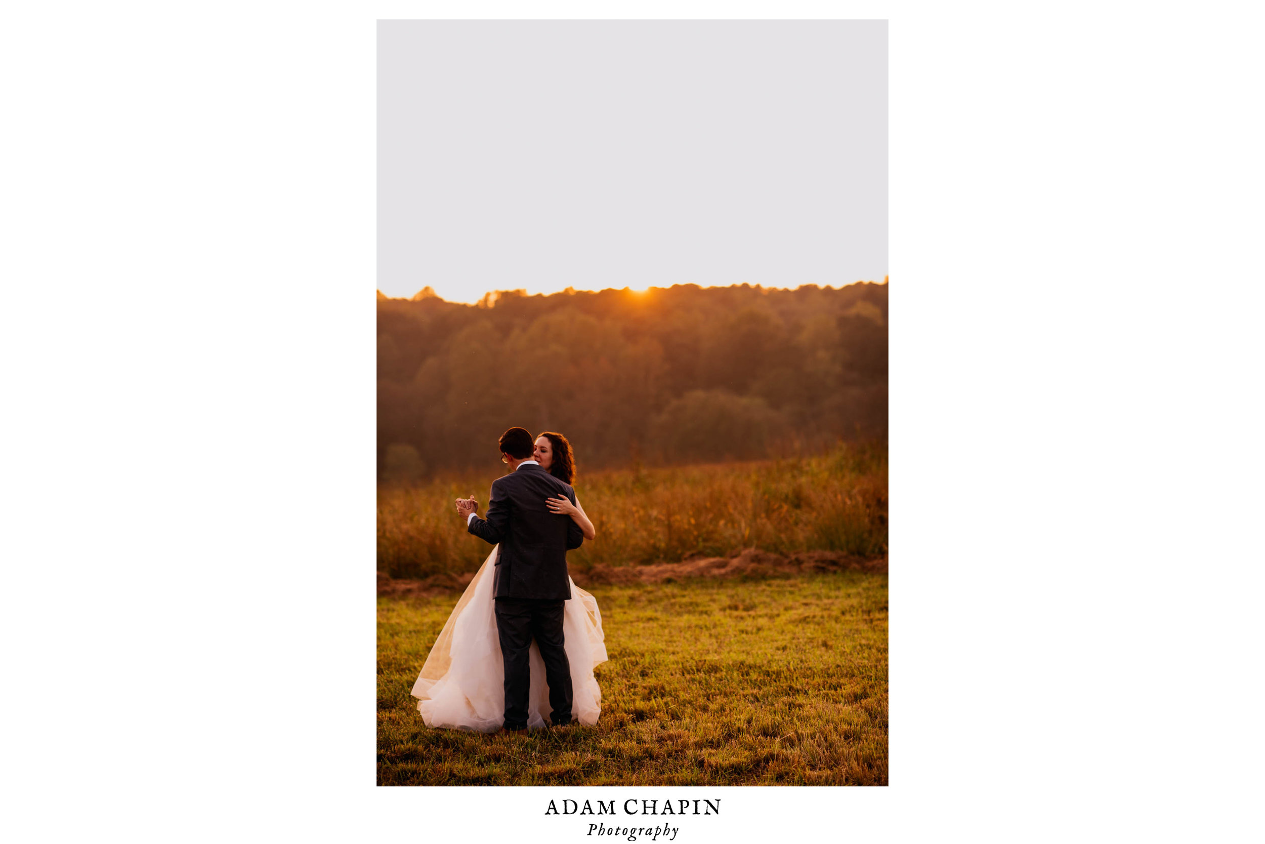 bride and groom dancing in a field in the sunset during their wedding day