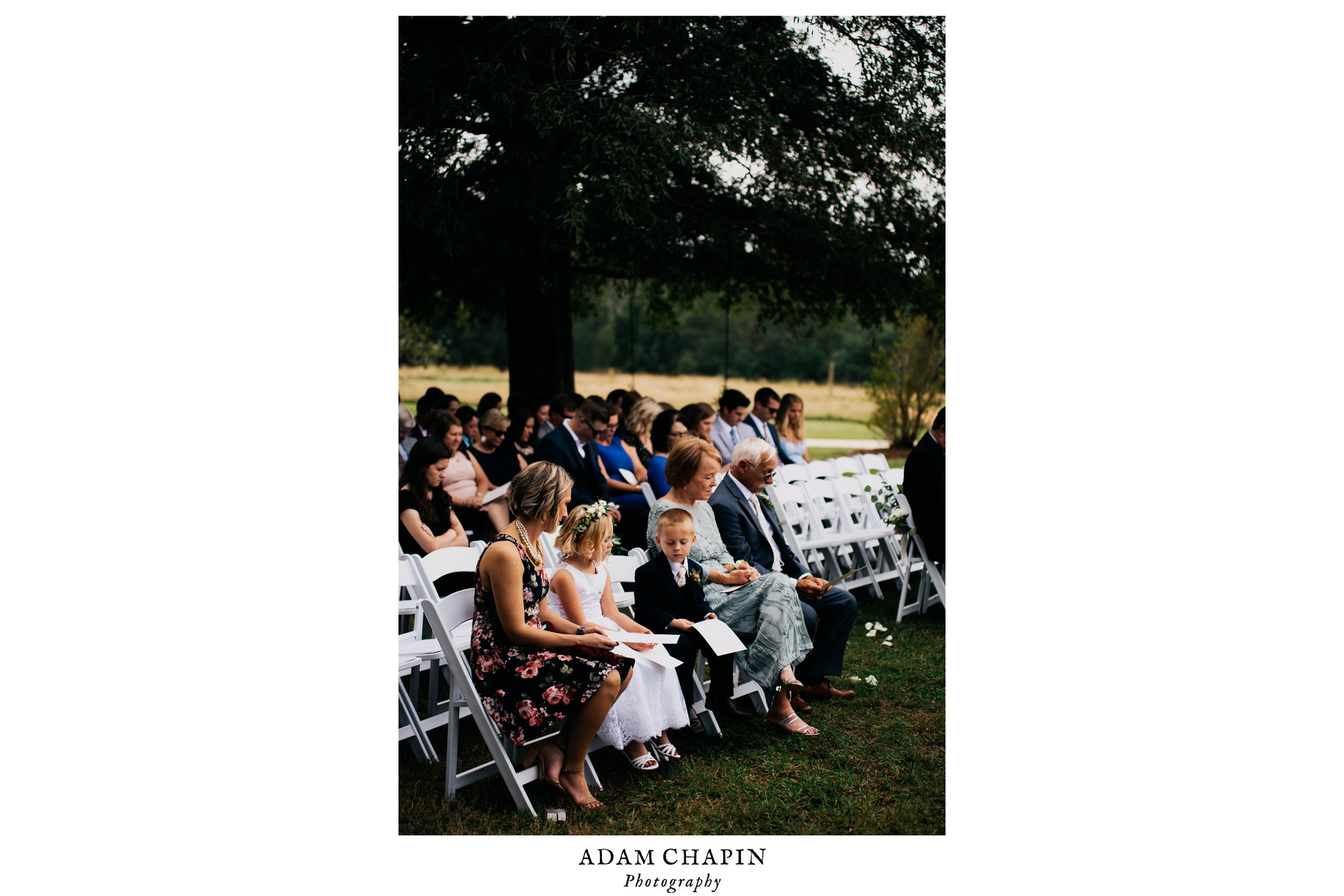 bride and grooms family looking on during their wedding ceremony