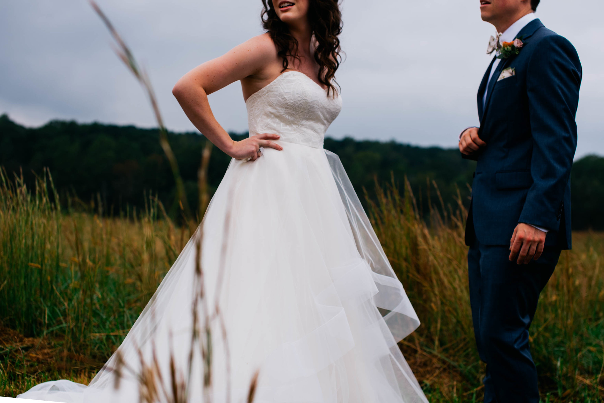 a cropped photo of the bride and groom to show the brides dress and the grooms suit details