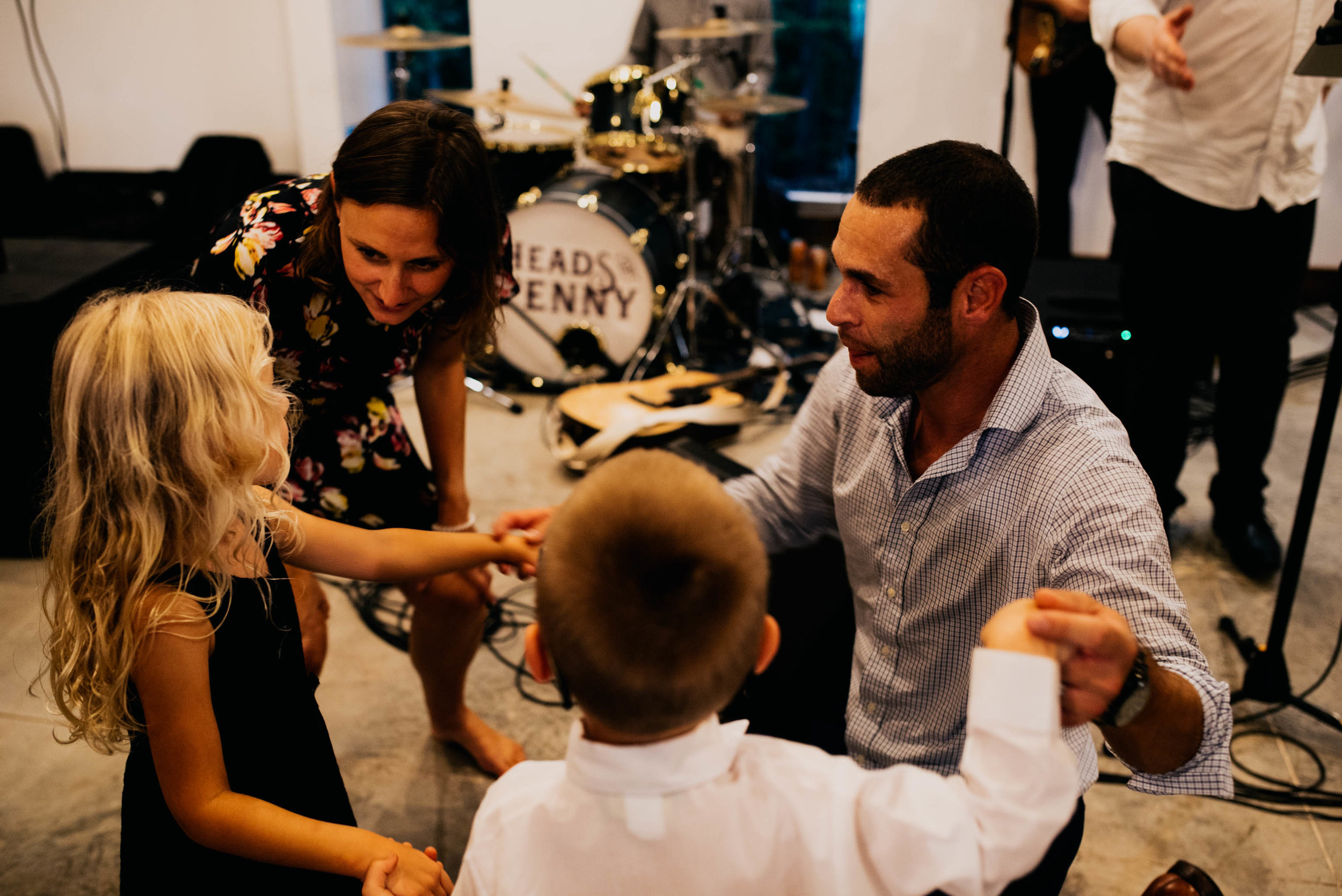 wedding guests dance with their kids during the wedding reception
