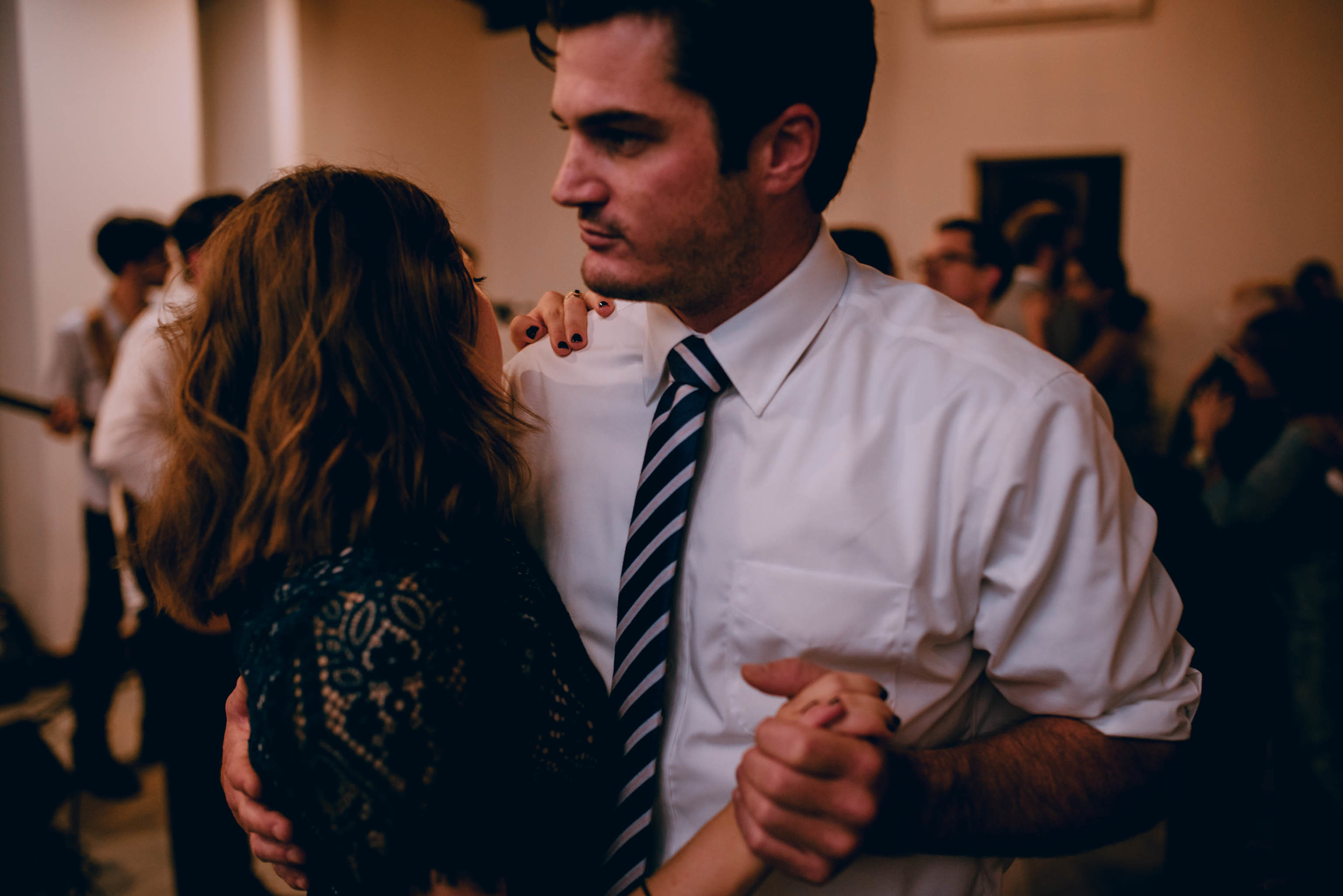 wedding guests slow dancing during wedding reception
