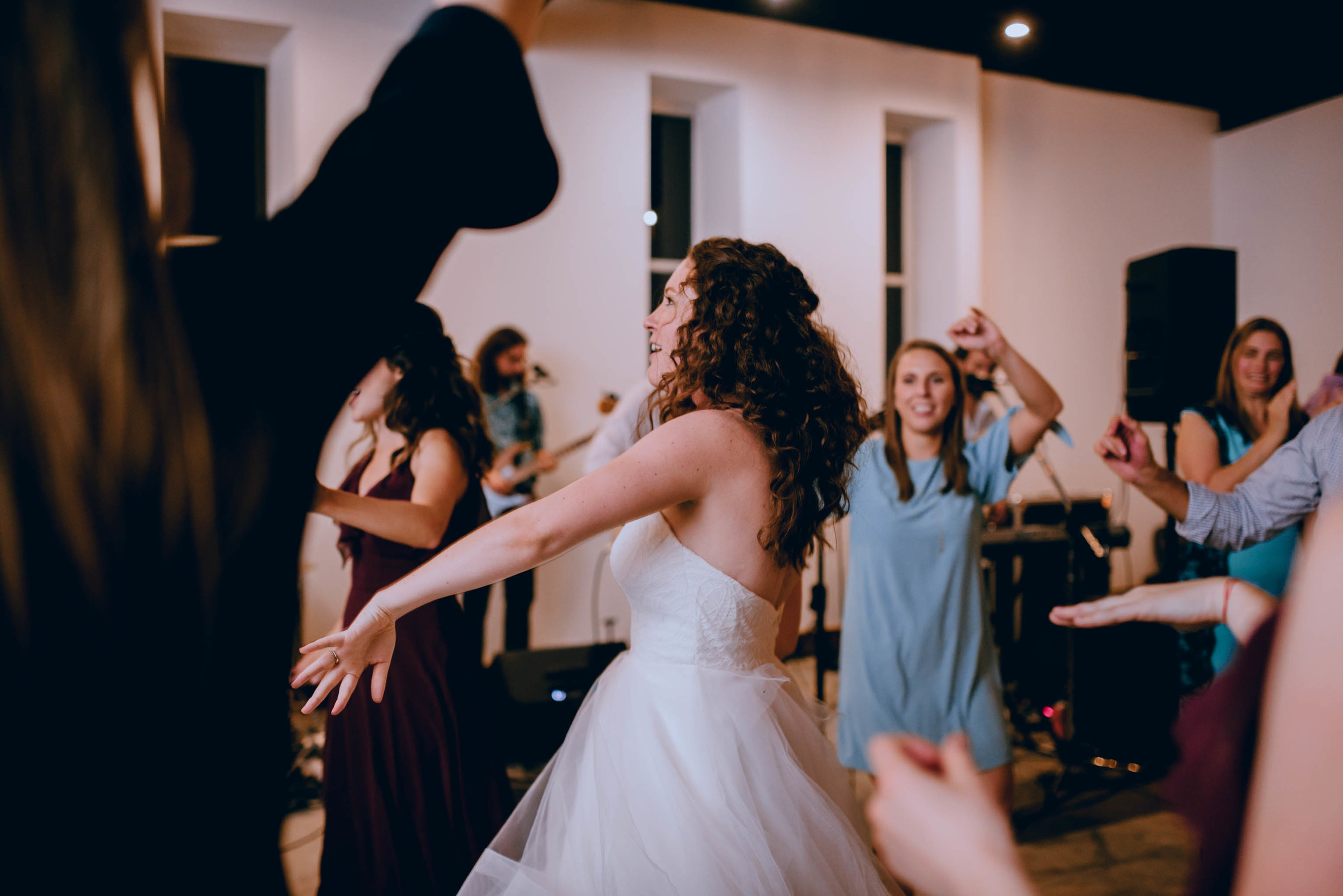 bride dancing with her bridesmaids during wedding reception