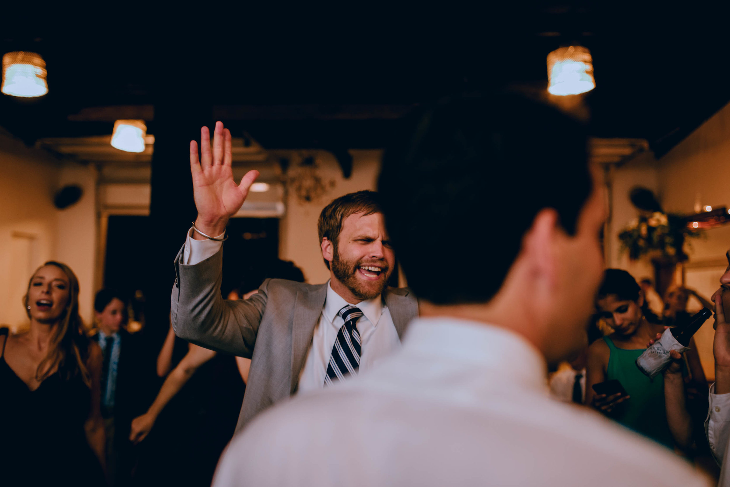 wedding guests getting funky during wedding reception