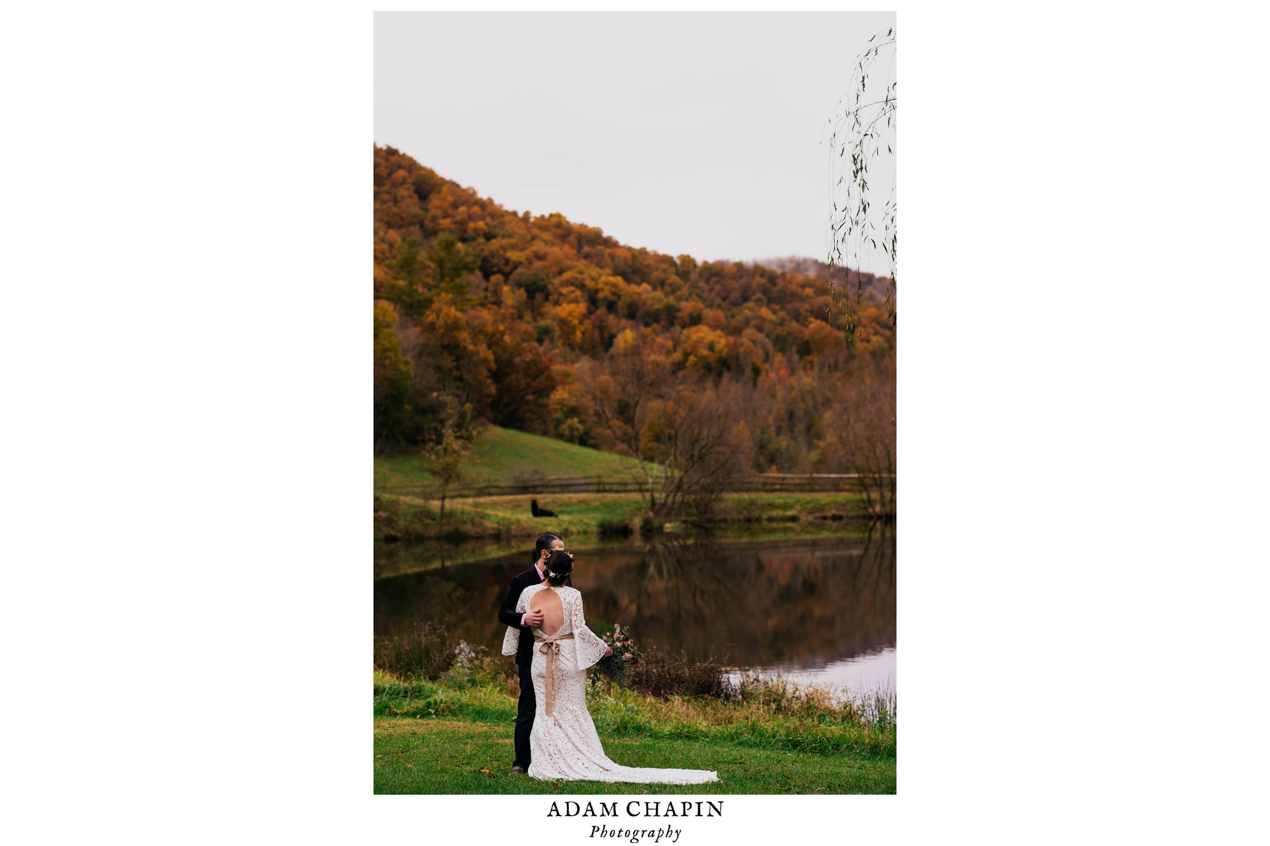 bride and groom standing together with mountains full of fall colors behind them