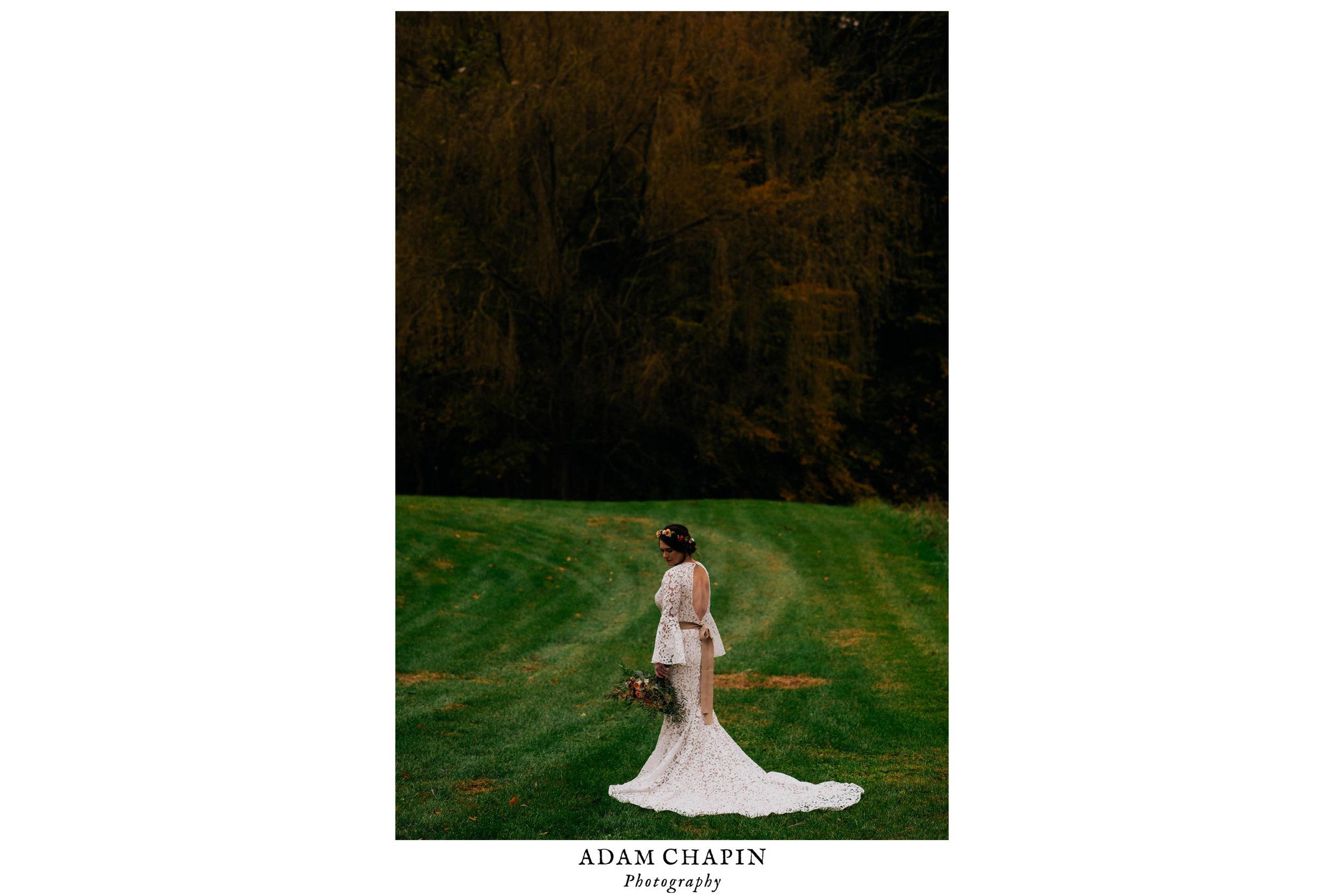 bride standing in her lillian west wedding dress