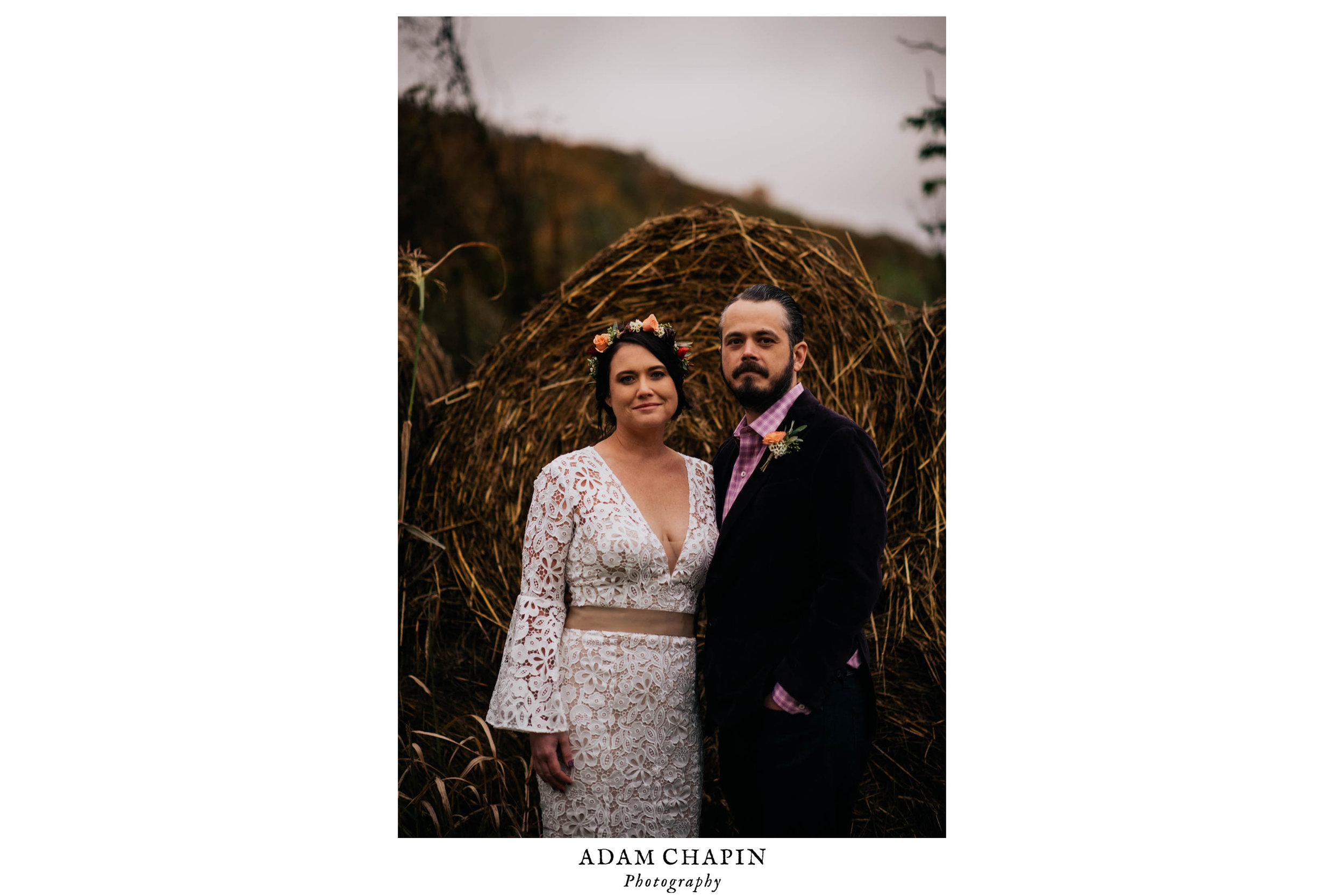 bride and smiling  and posing in front of the hay bails