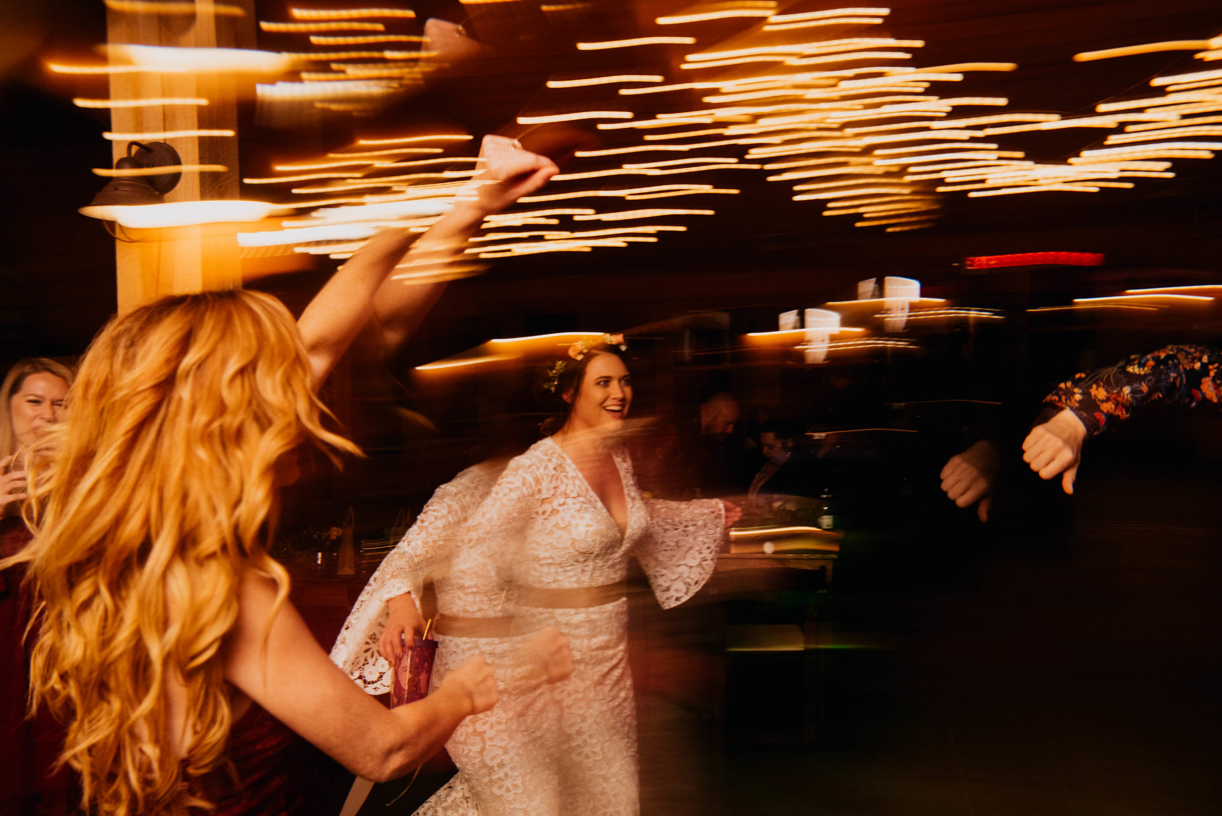 fun light trails while bride is dancing with her friends