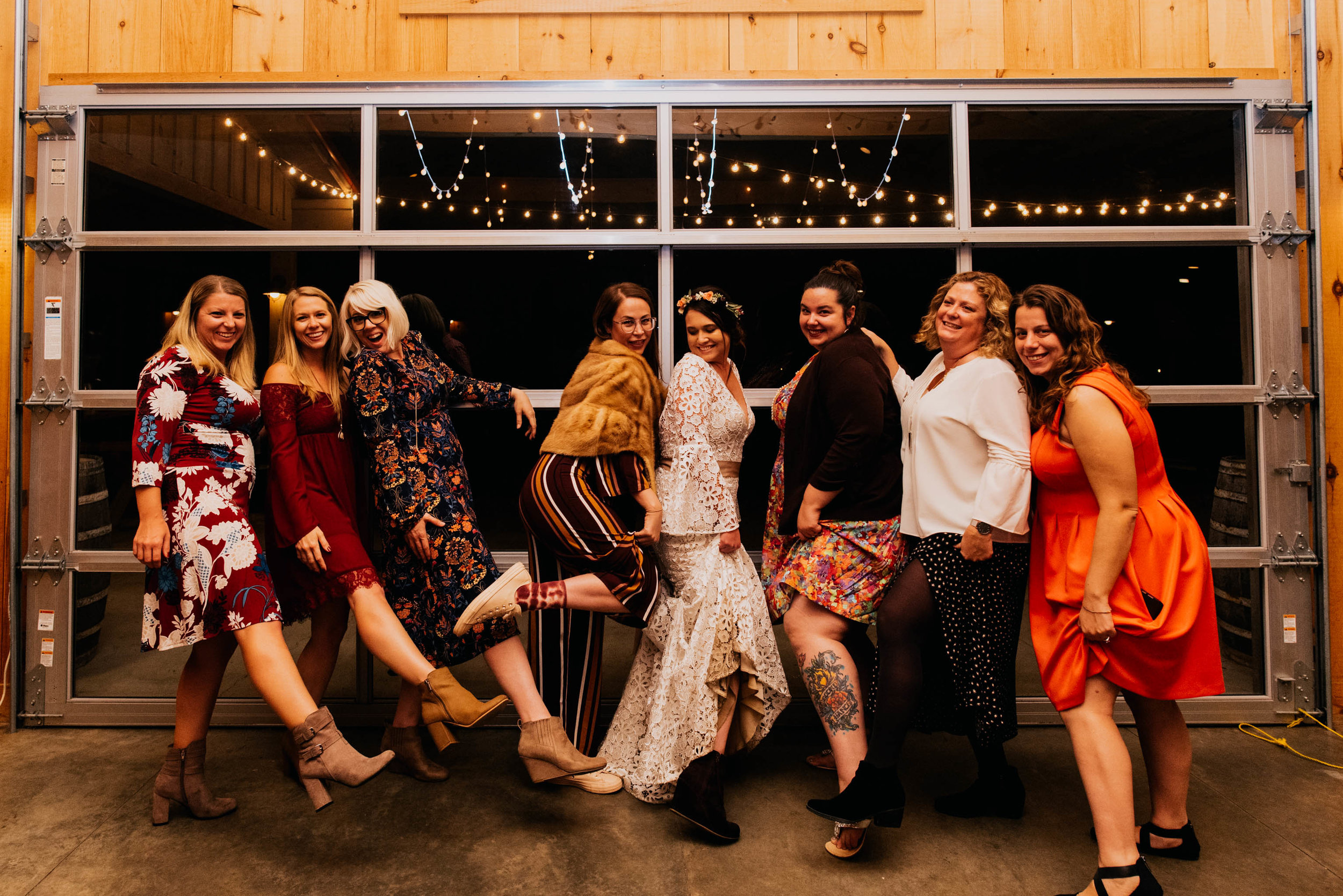 bride and all of her friends showing some leg together at the end of the night