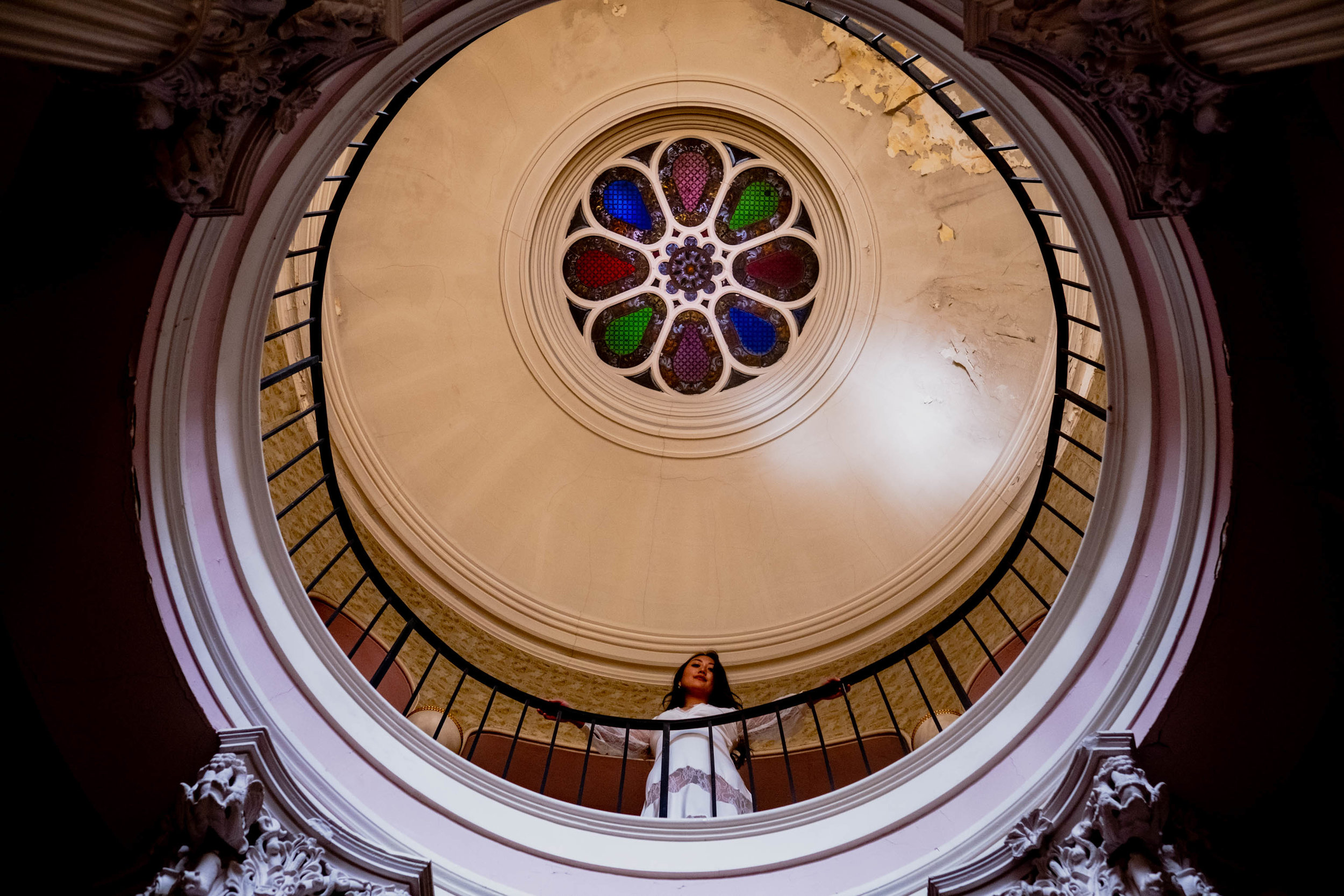 Bride standing underneath the stained glass cupola of the Montfort House in Raleigh, NC