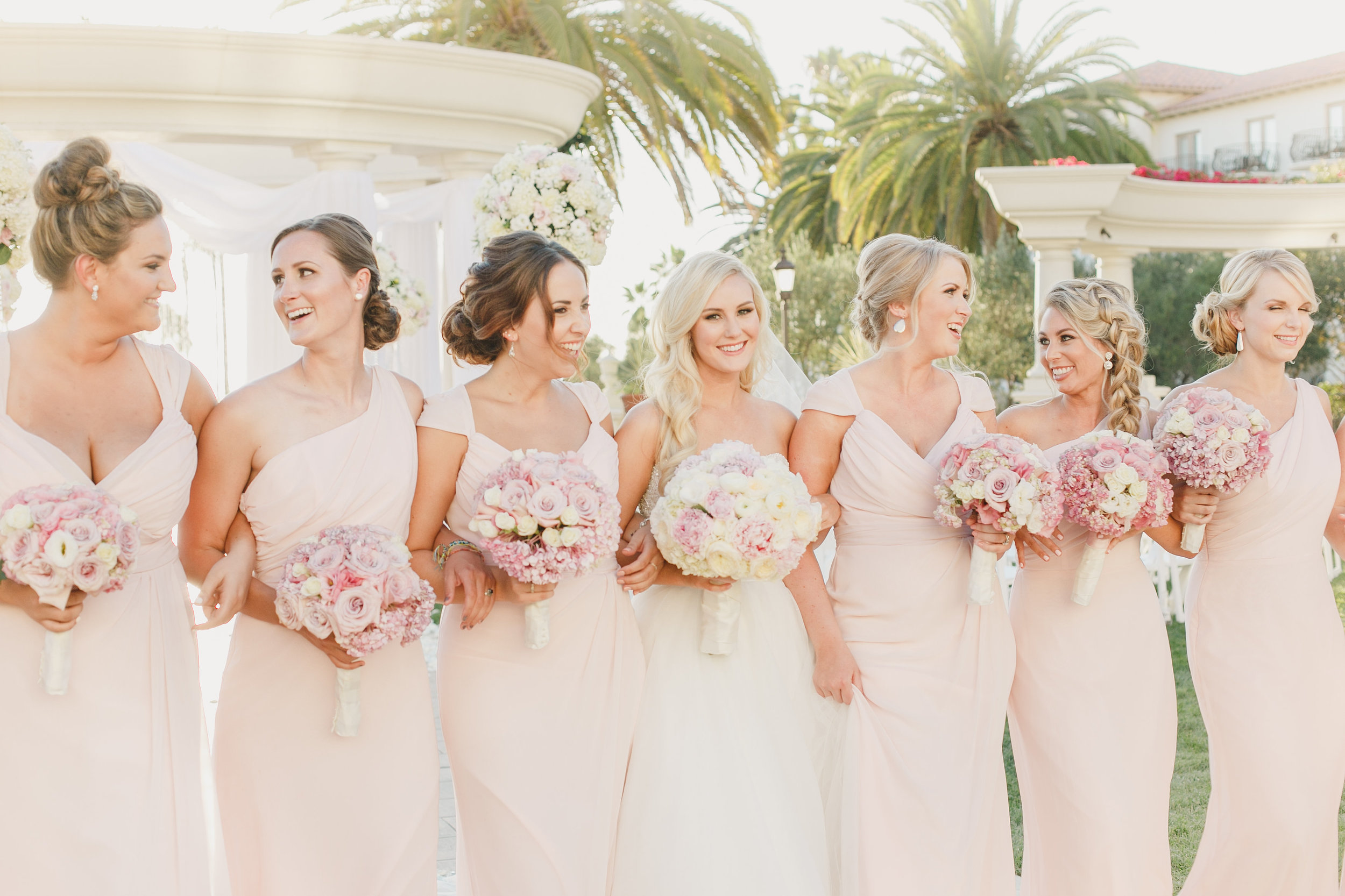 You can see the entire wedding look was soft and glamorous. Since Megan's hair was all down Genna and the DV artists braided and created soft up dos for all the bridesmaids.
