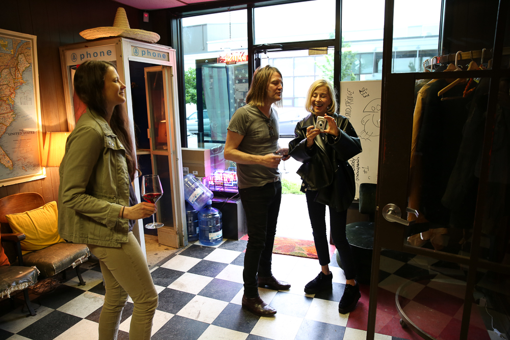Paige shows some of her recent shots to Courtney and his wife at the K&L wine event in Portland