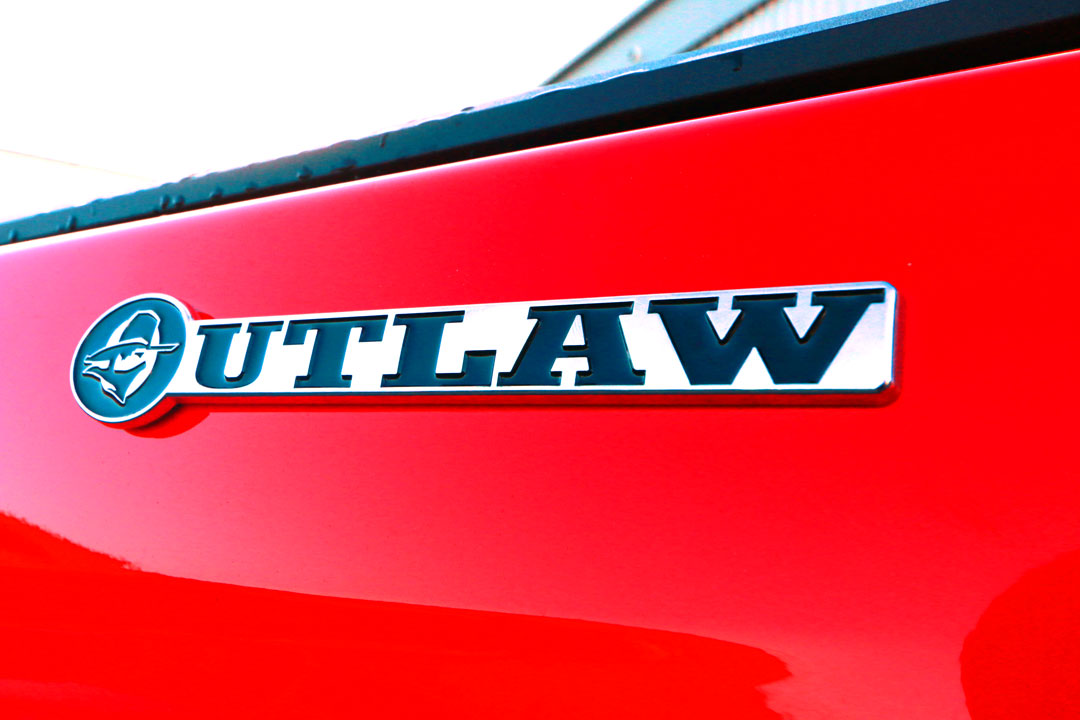 Outlaw_badge_on_red_LR.jpg