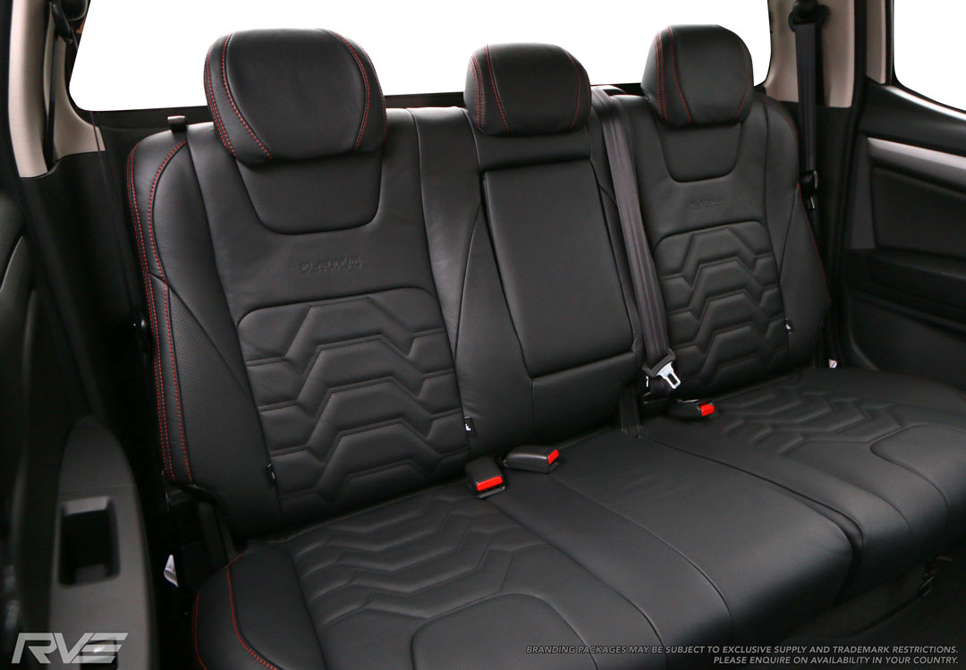 Holden Colorado Upgrade rear seating black leather, 'armour' inserts with black stitching, red bolster stitching, and Platinum Edition logo embossing