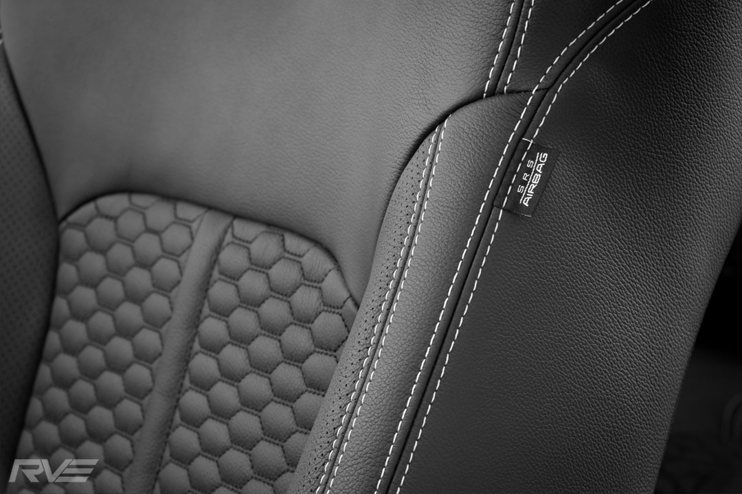 Upgraded XSV tombstone sport seating with honeycomb inserts, silver stitching and XSV embossed logos.
