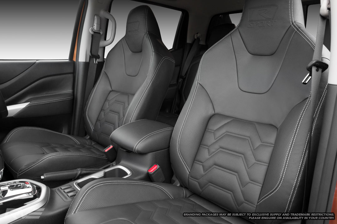 Upgraded Tombstone seats in black leather, perforated inner bolsters,silver stitching, black Armour inserts and embossed R-Sport logos.