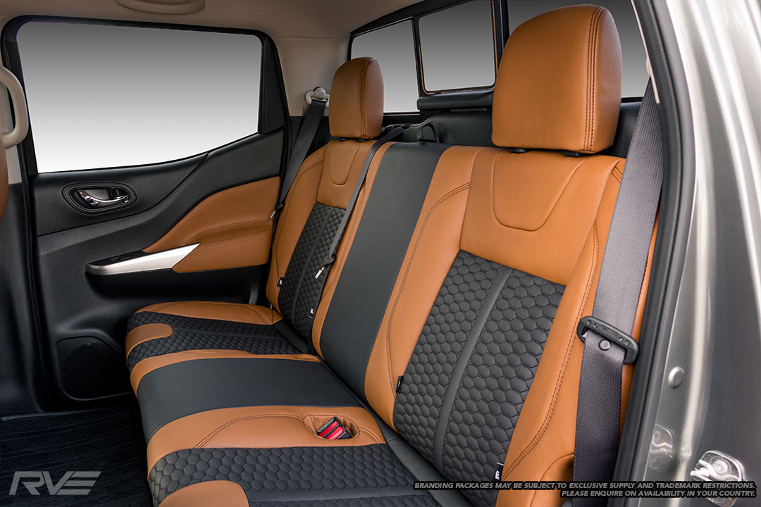 Upgraded tombstone sports seats in saddle brown leather with black honeycomb inserts and black stitching.