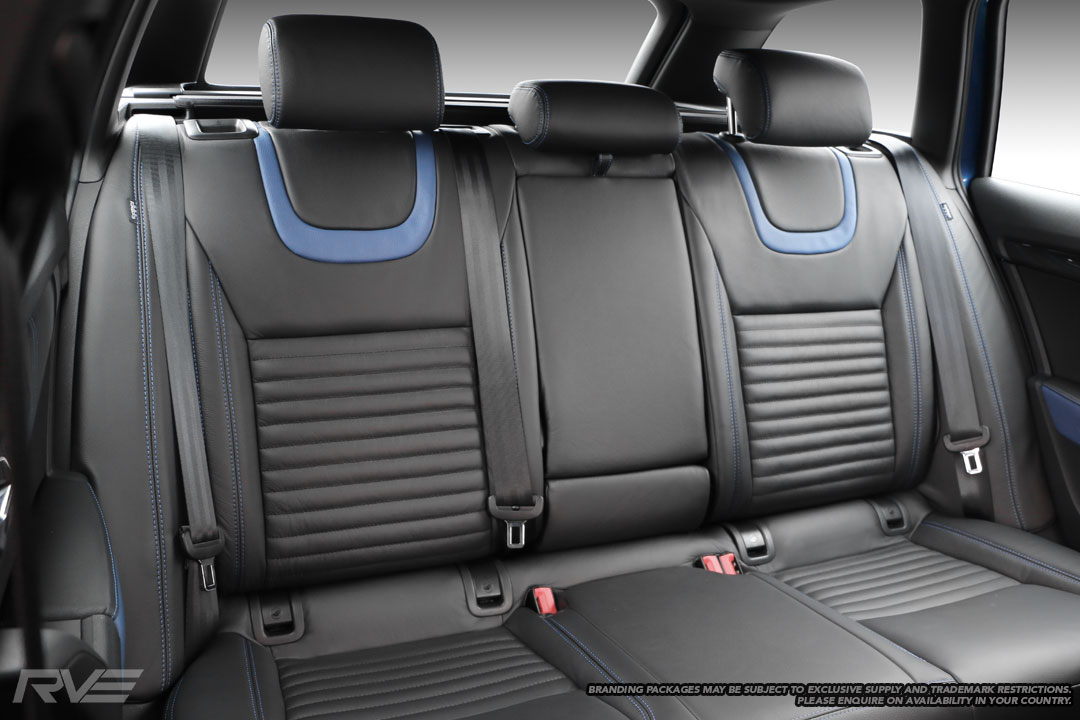 Skoda Octavia - Standard seats in black leather with blue highlights under headrests, flat inserts with black stitched lines, and blue stitching on bolsters.