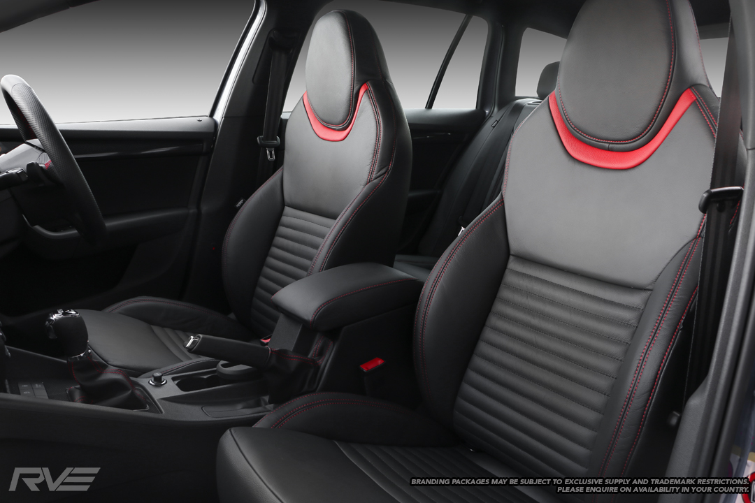 Skoda Octavia - Standard seats in black leather with red highlights under headrests, flat inserts with black stitched lines, and red stitching on bolsters.