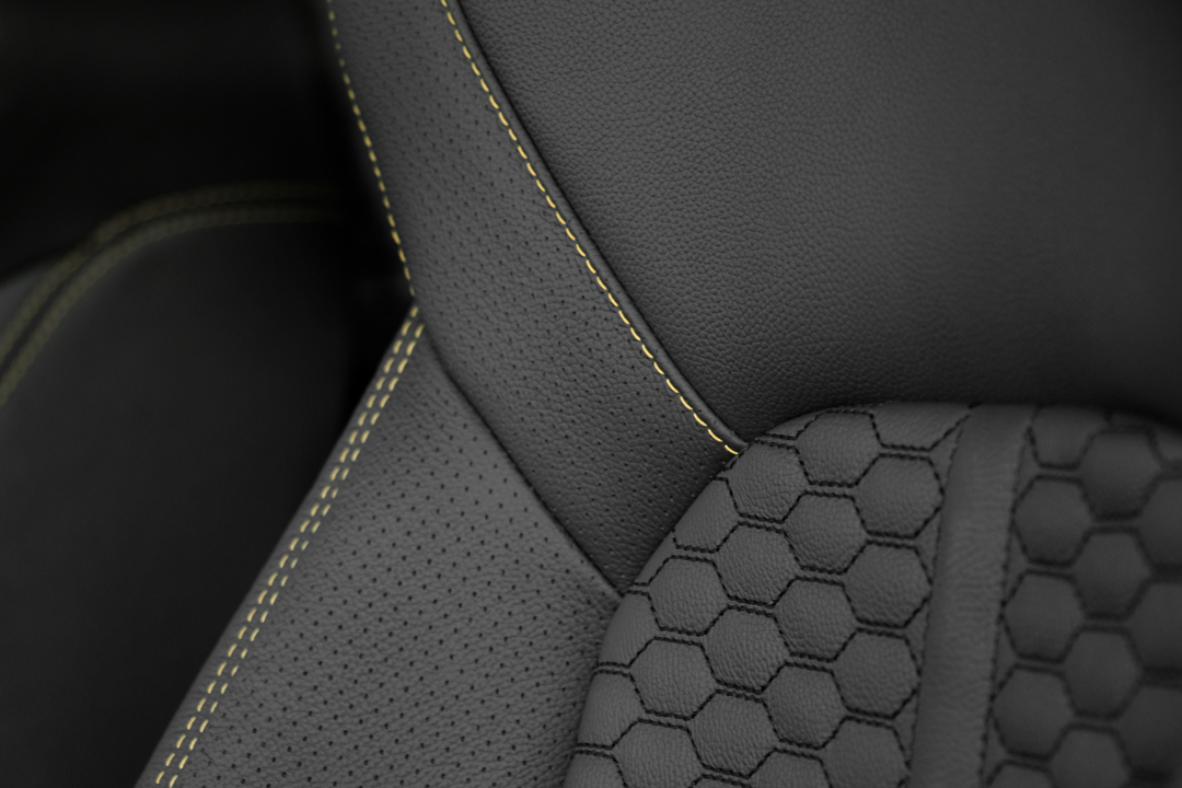 Contrast stitching with honeycomb inserts and perforated bolsters