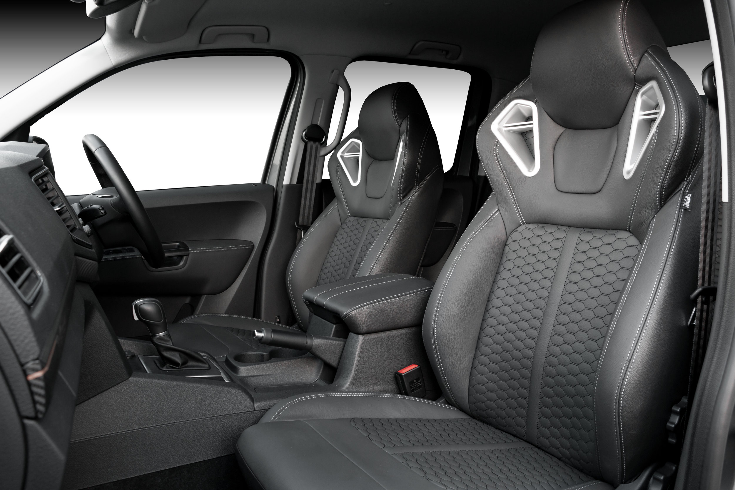 2019 VW Amarok with X-RS package.  Upgraded Monza sport seats in OEM spec black leather, silver stitching and designer honeycomb inserts.