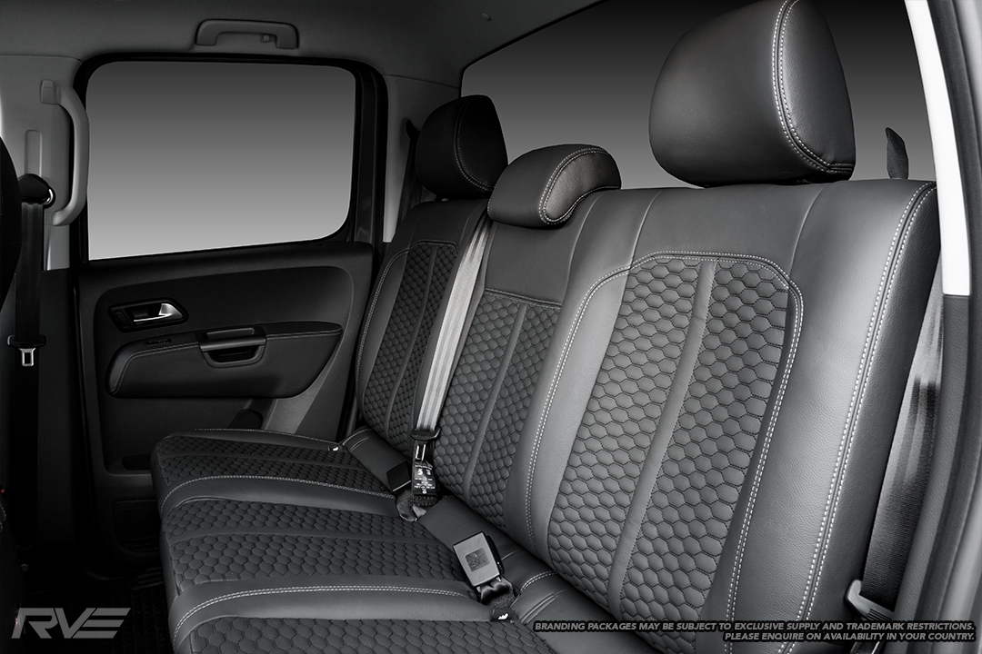 Upgraded Monza sport seats in OEM black leather with silver stitching and black stitched honeycomb inserts.