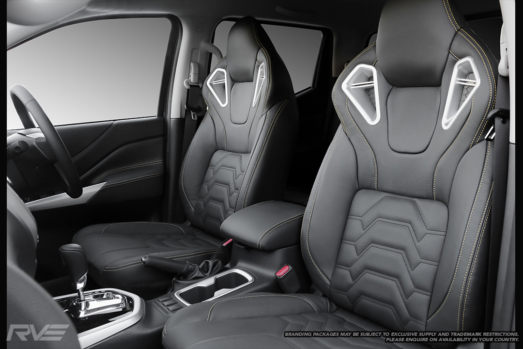 Upgraded Monza sport seats in OEM spec black leather with yellow highlight stitching and armour inserts.