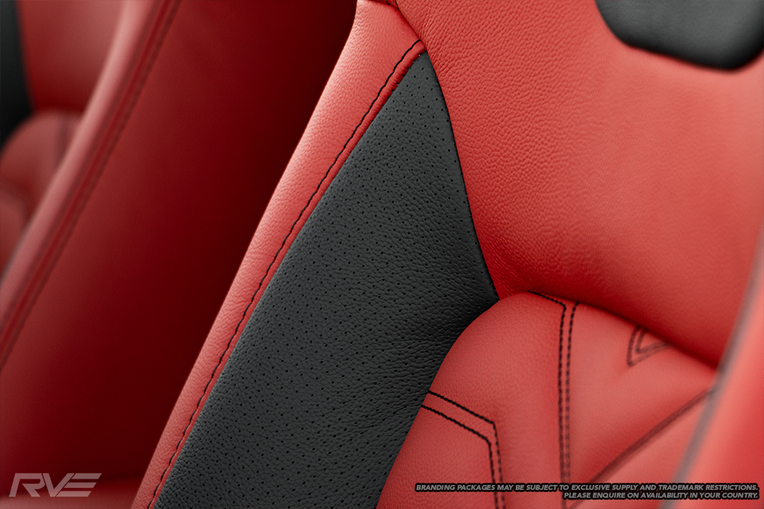 Upgraded gull-wing sport seats in red leather with black perforated highlights, 'X' inserts and black stitching.