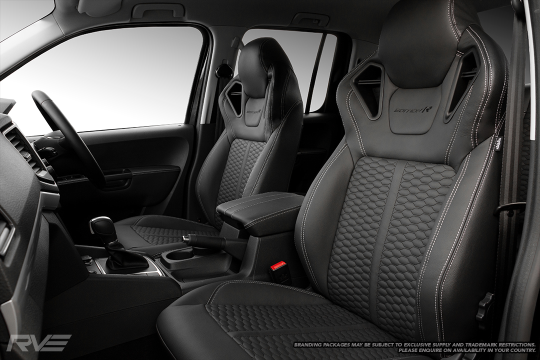 2019 VW Amarok with Monza sport seats in OEM spec black leather with silver stitching, honeycomb inserts, satin black shoulder accents and black embroidered logos.