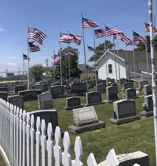 Flags fly high on Tangier Island.