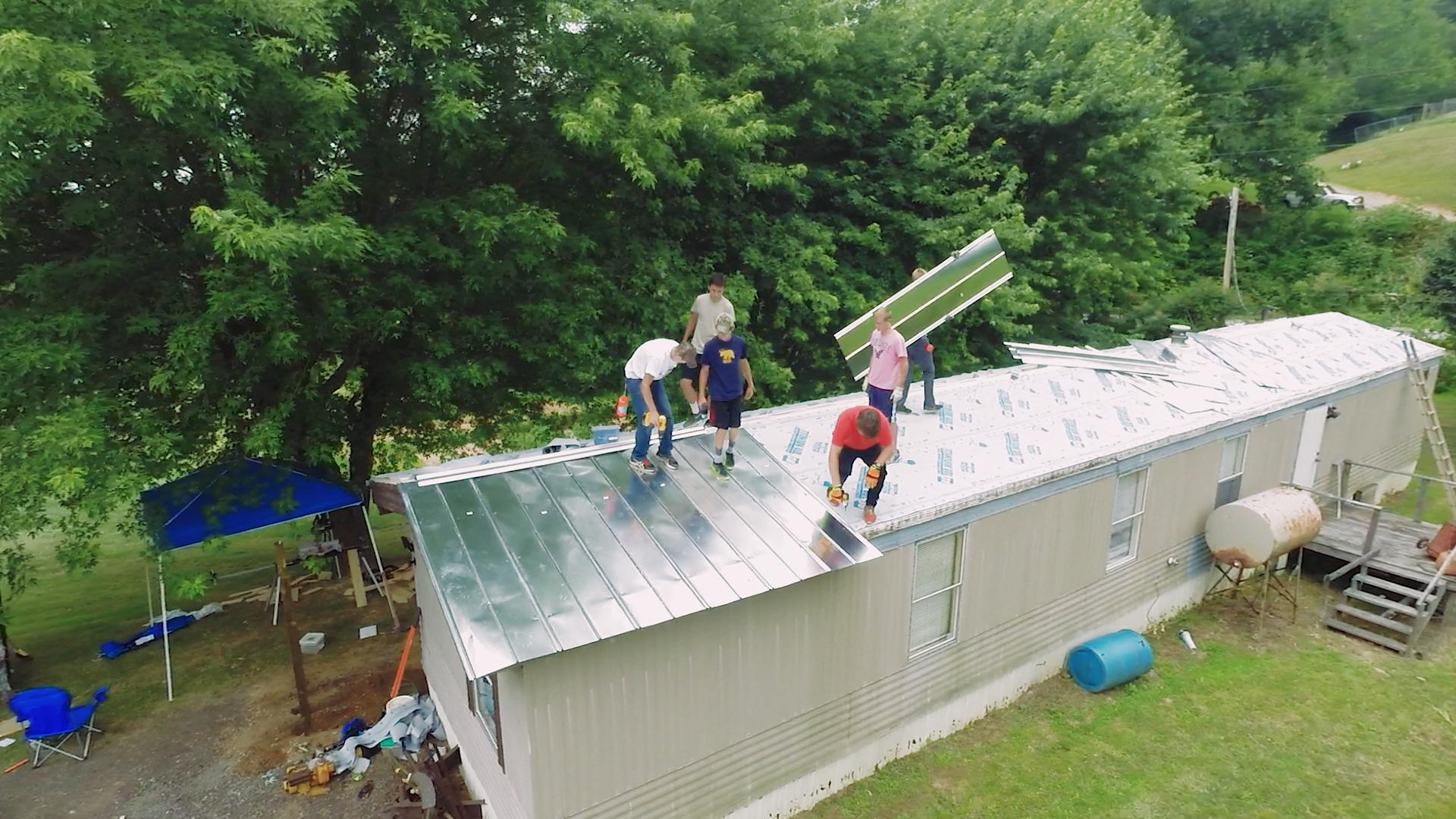 kids on roof.jpg