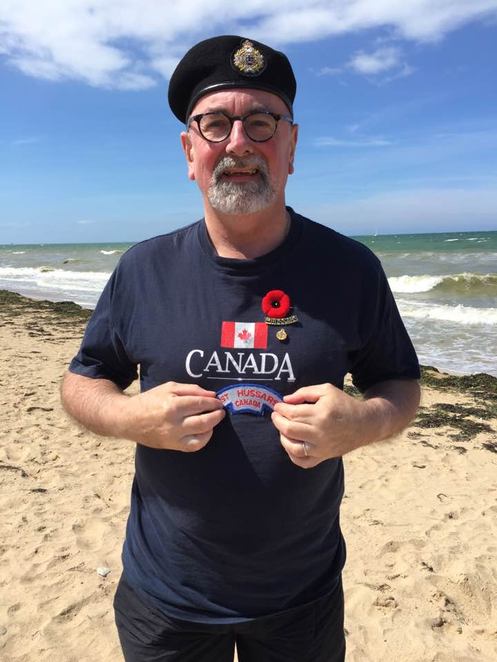 On Juno Beach, praying my beret doesn't blow off!