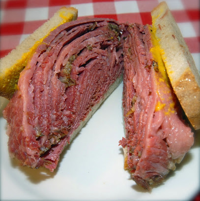 ($) Schwartz's - 3895 Saint-Laurent boul.Restaurant specializing in smoked meat.