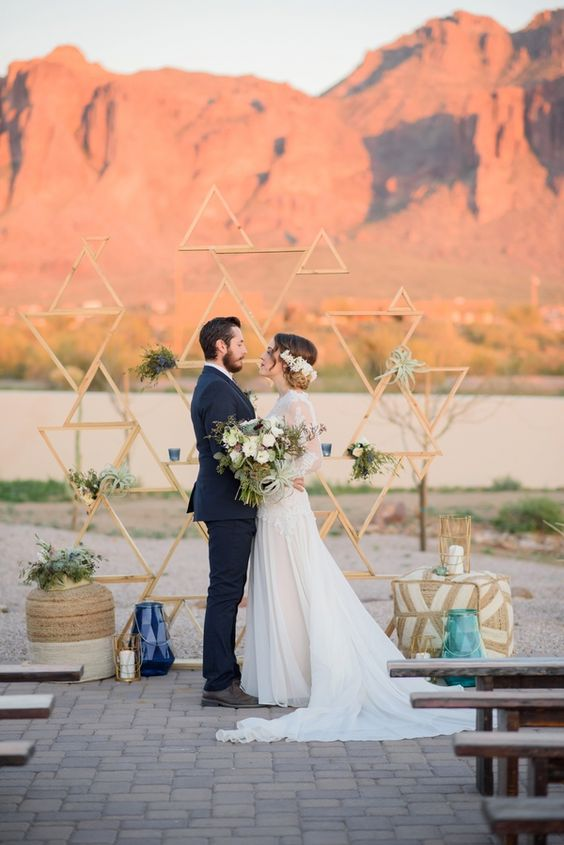19-wooden-triangle-backdrop-with-candles-air-plants-and-candle-lanterns.jpg