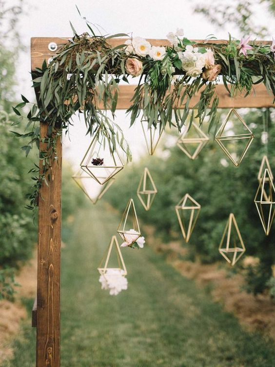 23-a-wooden-arch-covered-in-delicate-florals-hanging-geometric-figures.jpg