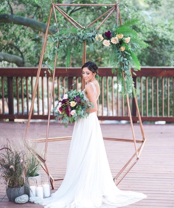 29-copper-dimensional-wedding-arbor-with-greenery-and-flowers-for-a-modern-feel.jpg