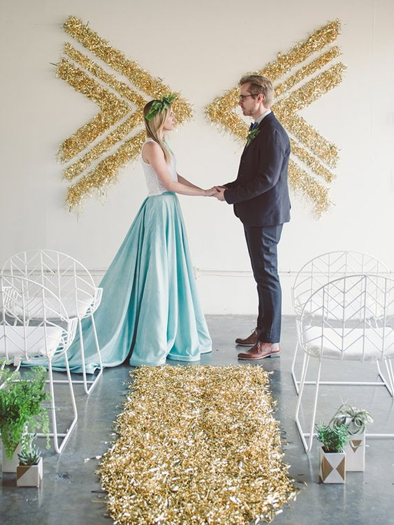 30-gold-glitter-ceremony-backdrop-of-chevrons-made-on-the-wall.jpg