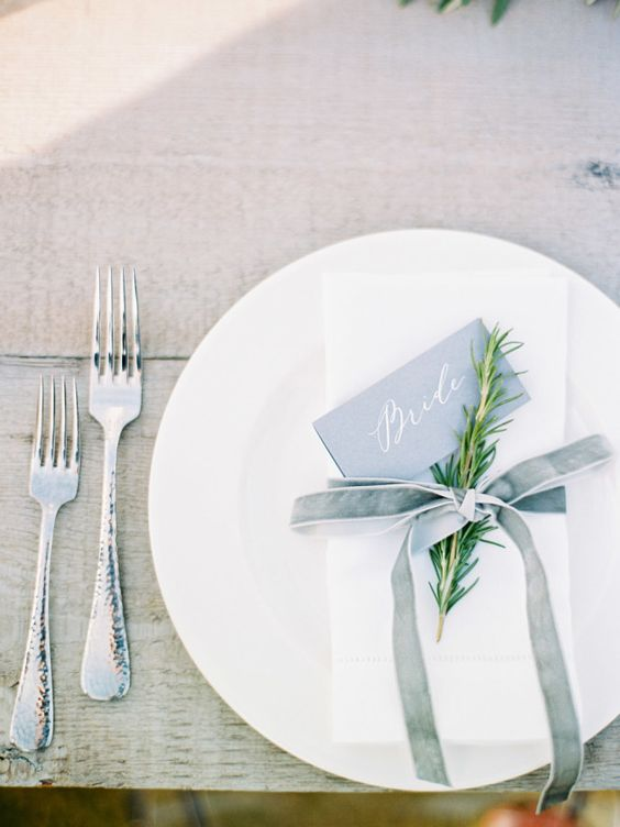 20-a-minimalist-table-setting-with-a-white-napkin-and-a-dusty-blue-velvet-ribbon.jpg