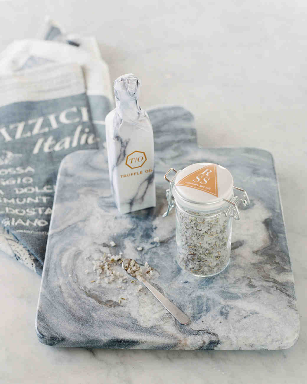 dennis-bryan-wedding-italy-salt-oil-favors-006-0070-s112633_vert.jpg