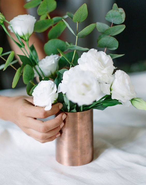 22-copper-vase-with-white-flowers-and-greenery-for-a-centerpiece.jpg